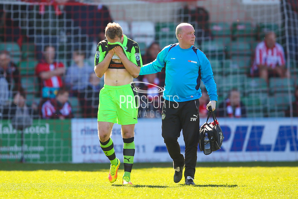 Forest Green Rovers defender, on loan from Carlisle United, Mark Ellis (5) feels a knock after Lincoln City first goal during the Vanarama National League match between Lincoln City and Forest Green Rovers at Sincil Bank, Lincoln, United Kingdom on 25 March 2017. Photo by Simon Davies.