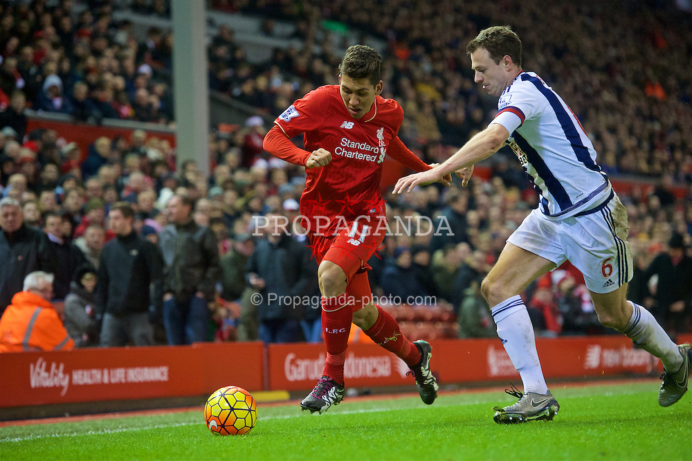 LIVERPOOL, ENGLAND - Sunday, December 13, 2015: Liverpool's Roberto Firmino in action against West Bromwich Albion's Jonny Evans during the Premier League match at Anfield. (Pic by James Maloney/Propaganda)