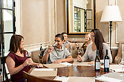 Young attractive couples wine tasting at Chalk  Hill Estate Vineyards in Healdsburg, California.