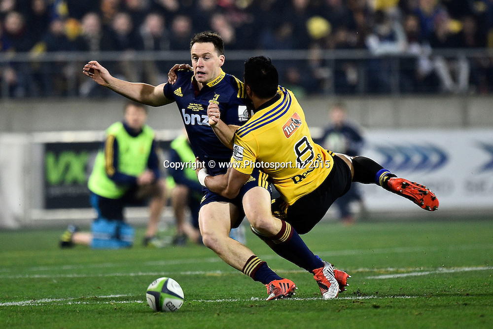 Ben Smith (L) of the Highlanders is tackled by Victor Vito of the Hurricanes during the Super Rugby final rugby match between the Hurricanes and Highlanders at the Westpac Stadium in Wellington on Saturday the 4th of July 2015. Copyright photo by Marty Melville / www.Photosport.nz