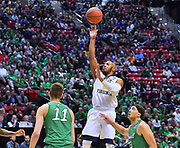 SAN DIEGO, CA - MARCH 18:  West Virginia Mountaineers guard Jevon Carter (2) shoots against Marshall Thundering Herd forward Ajdin Penava (11) and guard Jarrod West (13) during a second round game of the Men's NCAA Basketball Tournament at Viejas Arena in San Diego, California. West Virginia won 94-71.  (Photo by Sam Wasson)
