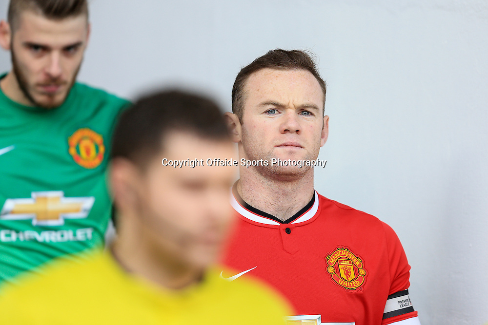 28 December 2014 - Barclays Premier League - Tottenham Hotspur v Manchester United - Wayne Rooney of Manchester United looks on as he walks from the players tunnel with Manchester United goalkeeper, David de Gea - Photo: Marc Atkins / Offside.