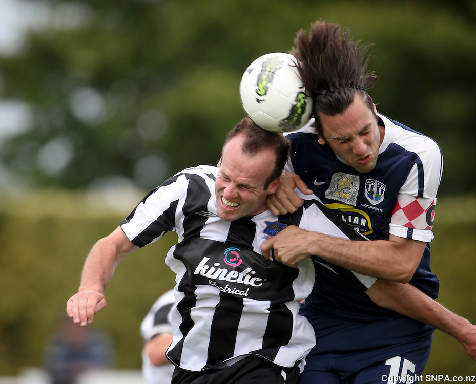 Hawkes Bay United's Leon Birnie (L) and Auckland City's Ivan Vicelich contest a high ball in the teams ASB Premiership Football match at Park Island, Napier, New Zealand, 06 February 2012, Photo: SNPA / John Cowpland
