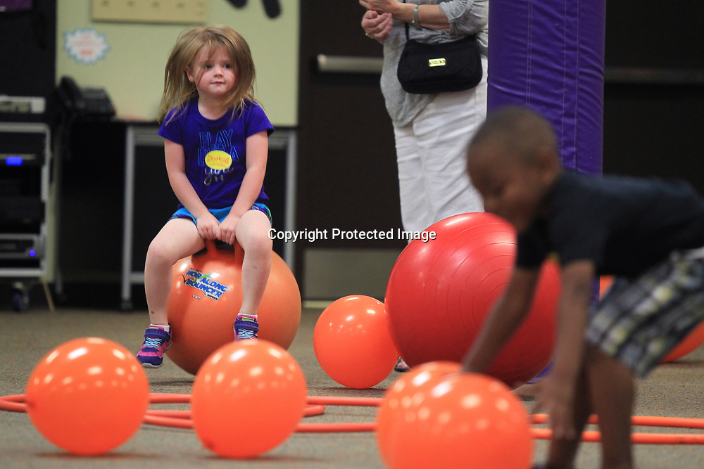 Harper Locke, 3 of Saltillo, jumos around on the hippity hop as she plays in the Zoom Romm at HealthWorks during Fit and Fun Friday. The camp is for children and their adult relatives where they have story time, crafts and an obstacle course in the Zoom Room.
