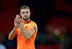 STOKE-ON-TRENT, ENGLAND - Wednesday, November 29, 2017: Liverpool's captain Jordan Henderson applauds the travelling supporters after the FA Premier League match between Stoke City and Liverpool at the  Bet365 Stadium. (Pic by David Rawcliffe/Propaganda)