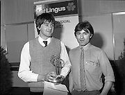 07/01/1983.01/07/1983.7th January 1983.The Aer Lingus Young Scientist Exhibition at the RDS, Dublin...Picture shows the winner Timothy Hickey from Colaiste De La Salle, Co. Cork being congratulated by his teacher Kevin Corcoran. .