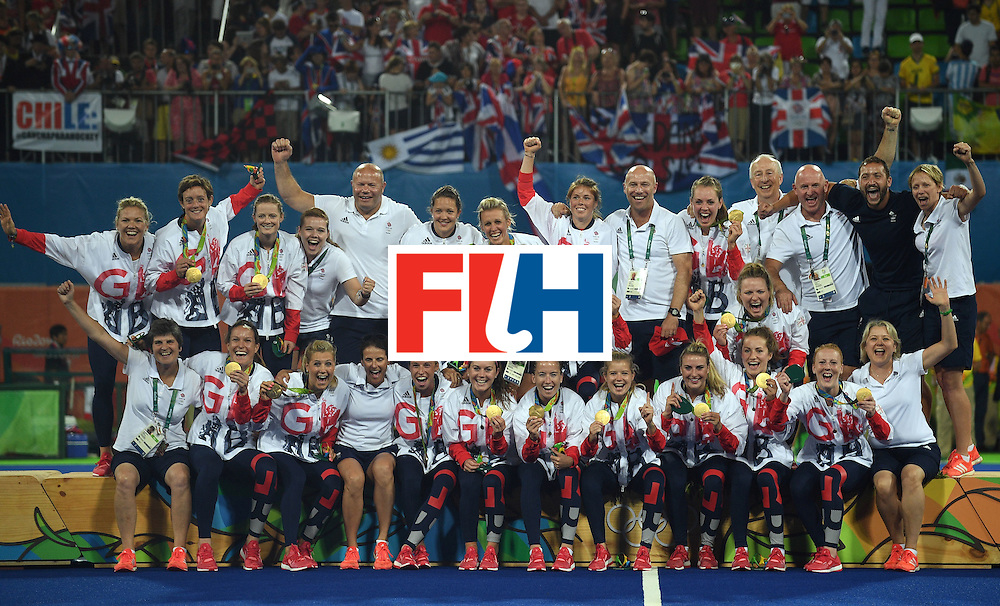 Britain's gold medallists celebrate on the podium during the women's field hockey medals ceremony of the Rio 2016 Olympics Games at the Olympic Hockey Centre in Rio de Janeiro on August 19, 2016. / AFP / MANAN VATSYAYANA        (Photo credit should read MANAN VATSYAYANA/AFP/Getty Images)