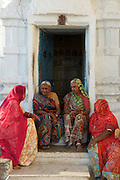Ladies chat on Gangaur Ghat, the city centre's main access point to Lake Pichola.