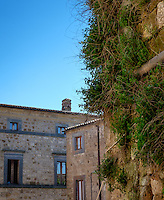 CIVITA DI BAGNOREGIO ITALY - CIRCA MAY 2015: Old walls and windows in Civita di Bagnoregio.