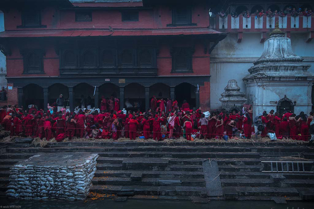 — In the brisk chill morning, the pilgrims arrive at the Pashupati Temple and undress to their ritual robe for that morning's ceremony.