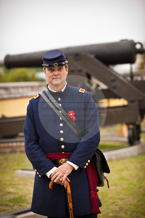 Confederate re-enactor poses in Fort Moultrie aimed at Fort Sumter in Charleston Harbor Charleston, SC. The re-enactors are part of the 150th commemoration of the US Civil War.