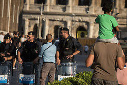 August 26, 2017 - Rome, Italy, Italy - Refugees and members of non governmental organizations stage a protest against eviction by Italian security forces and removing from a building where they had been living. (Credit Image: © Andrea Ronchini/Pacific Press via ZUMA Wire)
