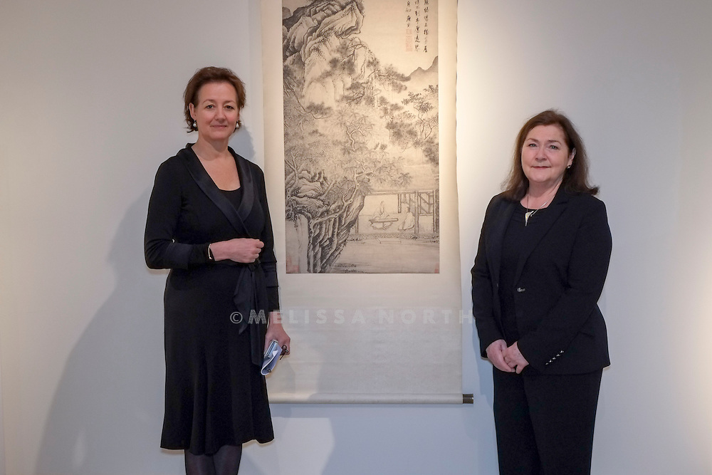 Rosemary E. Scott, International Academic Director and<br /> Leila de Vos van Steenwijk, Director, European Head Chinese Ceramics &amp; Works of Art, stand next to Tang Yin 'Playing the Zither'. From the touring highlights of The Collection of Robert Hatfield Ellsworth, on display<br /> at Christies in King St, London, UK on Tuesday 16th December 2014. In celebration of this unparalleled collection of Asian Art, Christie&rsquo;s will host a series of auctions and online-only sales during New York Asian Art Week in March 2015. Photo by Melissa North. Ref B5690