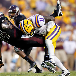 Sep 18, 2010; Baton Rouge, LA, USA;  LSU Tigers linebacker Kelvin Sheppard (11) hits Mississippi State Bulldogs quarterback Chris Relf (14) as he passed the ball during the first half at Tiger Stadium.  Mandatory Credit: Derick E. Hingle