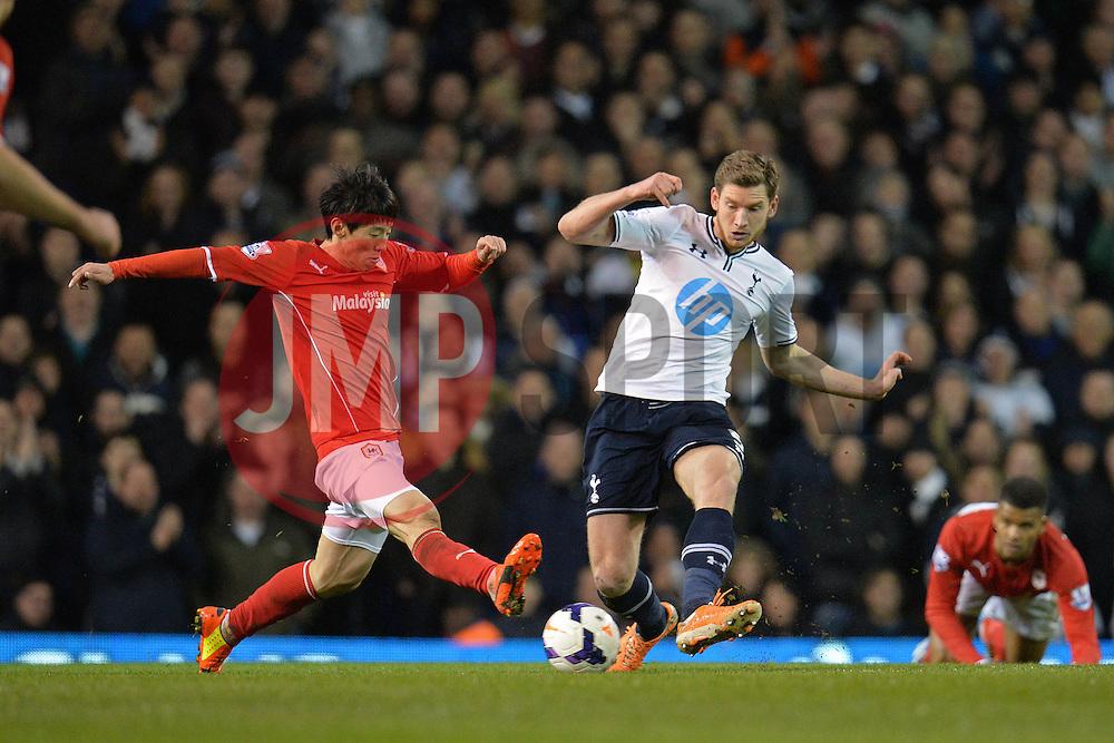 Cardiff's Kim Bo-Kyung and Tottenham's Jan Vertonghen  - Photo mandatory by-line: Mitchell Gunn/JMP - Tel: Mobile: 07966 386802 02/03/2014 - SPORT - FOOTBALL - White Hart Lane - London - Tottenham Hotspur v Cardiff City - Premier League