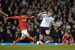 Cardiff's Kim Bo-Kyung and Tottenham's Jan Vertonghen  - Photo mandatory by-line: Mitchell Gunn/JMP - Tel: Mobile: 07966 386802 02/03/2014 - SPORT - FOOTBALL - White Hart Lane - London - Tottenham Hotspur v Cardiff City - Premier League