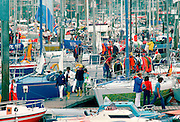 Yachting people at yachting marina in Cowes, Isle of Wight during the famous Cowes Week in August.