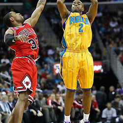 February 12, 2011; New Orleans, LA, USA; New Orleans Hornets point guard Jarrett Jack (2) shoots over Chicago Bulls point guard C.J. Watson (32)  during the second quarter at the New Orleans Arena.   Mandatory Credit: Derick E. Hingle