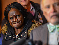 Gloria Darden (L), mother of the late Freddie Gray, listens to media questions during a family news conference outside the courthouse in Baltimore, December 16, 2015. Photo by Bryan Wolston / REUTERS