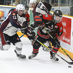 "TRENTON, ON  - MAY 2,  2017: Canadian Junior Hockey League, Central Canadian Jr. ""A"" Championship. The Dudley Hewitt Cup. Game 1 between Dryden GM Ice Dogs and the Georgetown Raiders.   Jordan Crocker #9 of the Georgetown Raiders fights off  Cory Dennis #12 of the Dryden GM Ice Dogs during the second period<br /> (Photo by Alex D'Addese / OJHL Images)"