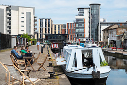 View of Union Canal at Lochrin Basin with cafe boat moored at Fountainbridge in Edinburgh, Scotland, United Kingdom, UK