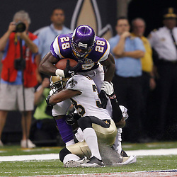 September 9, 2010; New Orleans, LA, USA; Minnesota Vikings running back Adrian Peterson (28) is tackled by New Orleans Saints cornerback Jabari Greer (33) during first half of the NFL Kickoff season opener at the Louisiana Superdome. Mandatory Credit: Derick E. Hingle