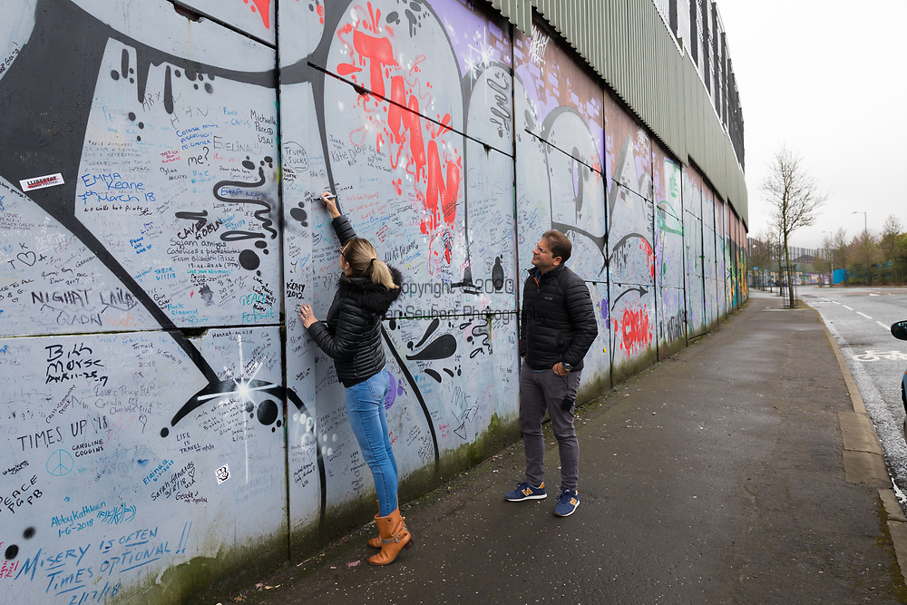 The Peace Wall with political murals in Belfast, Northern Ireland