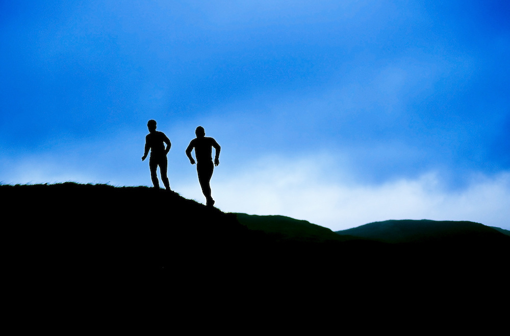 Fell runners on Shap Fell, Cumbria, UK