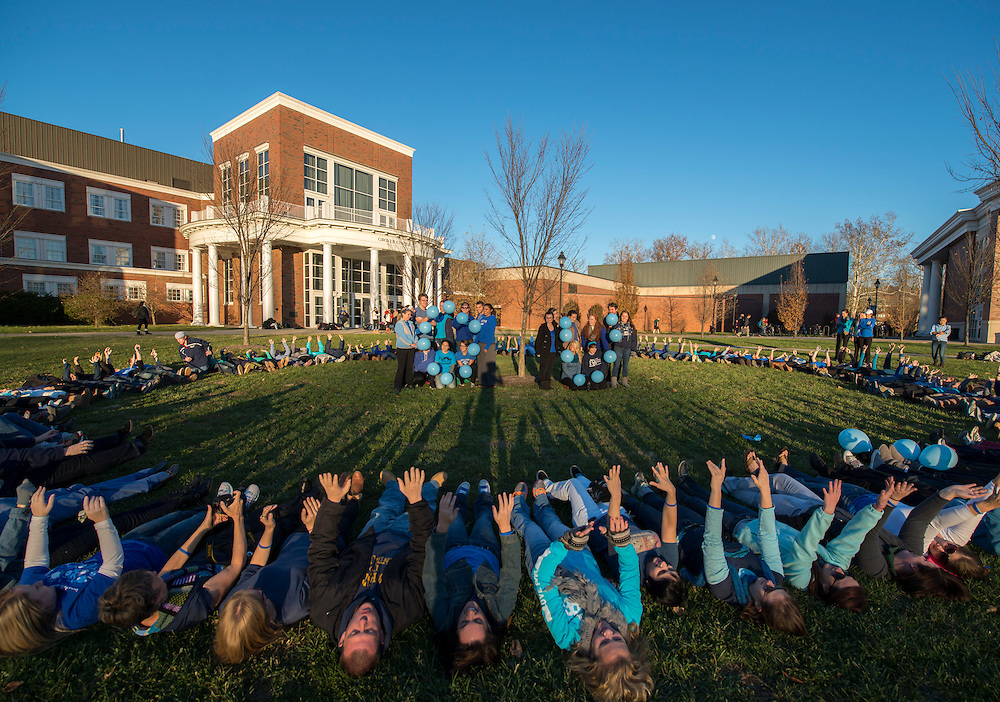 Faculty of The College of Health Sciences and Professions and students of Ohio University gather in Bicentennial Park to raise awareness for international Diabetes Day on November 14th, 2013. The color blue was picked to represent the cause, as students and faculty were encouraged to wear the color. Photo by Royle Mast.