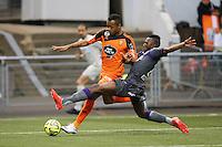 Jordan AYEW / Jacques MOUBANDJE - 18.04.2015 - Lorient / Toulouse - 33eme journee de Ligue 1<br />Photo : Vincent Michel / Icon Sport