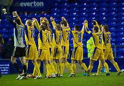 LIVERPOOL, ENGLAND - Thursday, December 17, 2009: FC BATE Borisov's side celebrate in front of their 72 travelling supporters as they beat Everton 1-0 during the UEFA Europa League Group I match at Goodison Park. (Pic by David Rawcliffe/Propaganda)