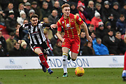 MK Dons midfielder Ryan Watson (7) and Grimsby Town player Elliot Embleton (22) during the EFL Sky Bet League 2 match between Grimsby Town FC and Milton Keynes Dons at Blundell Park, Grimsby, United Kingdom on 26 January 2019.