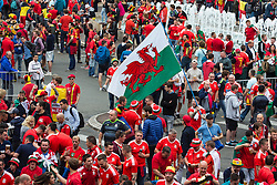 LILLE, FRANCE - Friday, July 1, 2016: A Wales fan waves a giant flag in the centre of Lille ahead of the UEFA Euro 2016 Championship Quarter-Final match against Belgium at the Stade Pierre Mauroy. (Pic by Paul Greenwood/Propaganda)