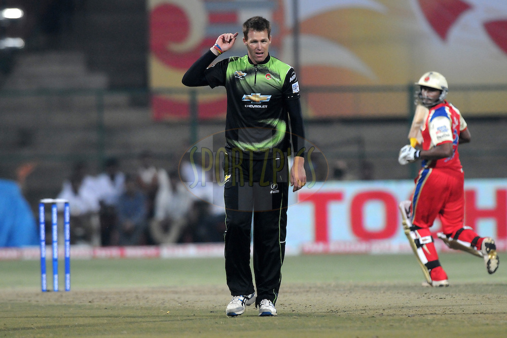 Rusty Theron of Warriors celebrates a wicket during match 1 of the NOKIA Champions League T20 ( CLT20 )between the Royal Challengers Bangalore and the Warriors held at the  M.Chinnaswamy Stadium in Bangalore , Karnataka, India on the 23rd September 2011..Photo by Pal Pillai/BCCI/SPORTZPICS