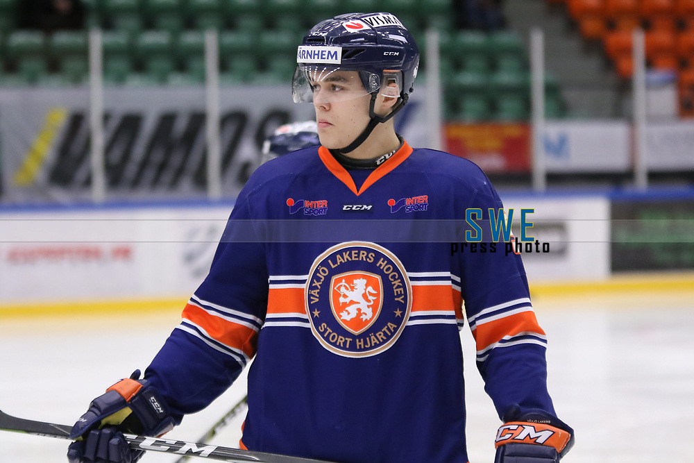 2018-04-02 | Nyk&ouml;ping, Sweden: V&auml;xj&ouml; August Nilsson (5) during the game between V&auml;xj&ouml; and HV71 at Nyk&ouml;pings Arenor ( Photo by: Fredrik Sten | Swe Press Photo )<br /> <br /> Keywords: Icehockey, Nyk&ouml;pings Arenor, Nyk&ouml;ping, J20, V&auml;xj&ouml;, HV71, playoffs, playoff, gold, gold-game, Junior, SM, JSM, Junior-SM, goldmedal, medal
