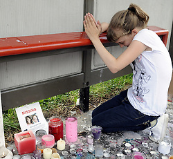 © Licensed to London News Pictures. 09/08/2012 .A girl praying at a bus stop near Castle Hill School and The Lindens.. Sixth day (09.08.2012) Tia Sharp has been missing..  12 years old Tia Sharp has been missing from the Lindens on The Fieldway Estate in New Addington,Croydon,Surrey since Friday last week. .Photo credit : Grant Falvey/LNP