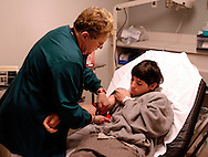 LANSDALE, PA - DECEMBER 10:  An Emergency Room nurse takes the blood pressure of patient David McCreary in the Emergency Room at Central Montgomery Medical Center December 10, 2004 in Lansdale, Pennsylvania. Central Montgomergy Medical Center is one of a number of hospitals in the United States which guarantees emergency room patients will be seen by a nurse in a certain time period or their visit is free. Hospitals in Michigan, Wisconsin, Ohio, New Jersey, and Nevada are offering similar promises to lure the sick and injured away from competitors. (Photo by William Thomas Cain/Getty Images)