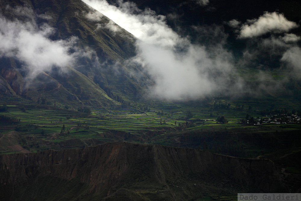 The Colca river sneaks through lustful green cultivated terraces near the village of Lari, Peru, Saturday, Jan. 29, 2011.