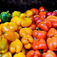 Green, Yellow, Orange and Red Bell Peppers at Farmers Market in Vancouver, Canada