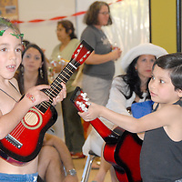 .Children play with their guitars to the  music of Michael Cladis during the MLH Kidz Party at Virginia Avenue park on Saturday, January 15, 2011.