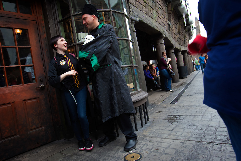 ORLANDO, FL -- January 5, 2011 -- Niki Pretti of Berkeley, Cali., gets an up close peek at an owl at The Wizarding World of Harry Potter at Universal Orlando in Orlando, Fl., January 5.  The 20-acre park features a new ride inside the Hogwarts Castle and shops along the village of Hogsmeade - which has been packed with fans since its opening in June.
