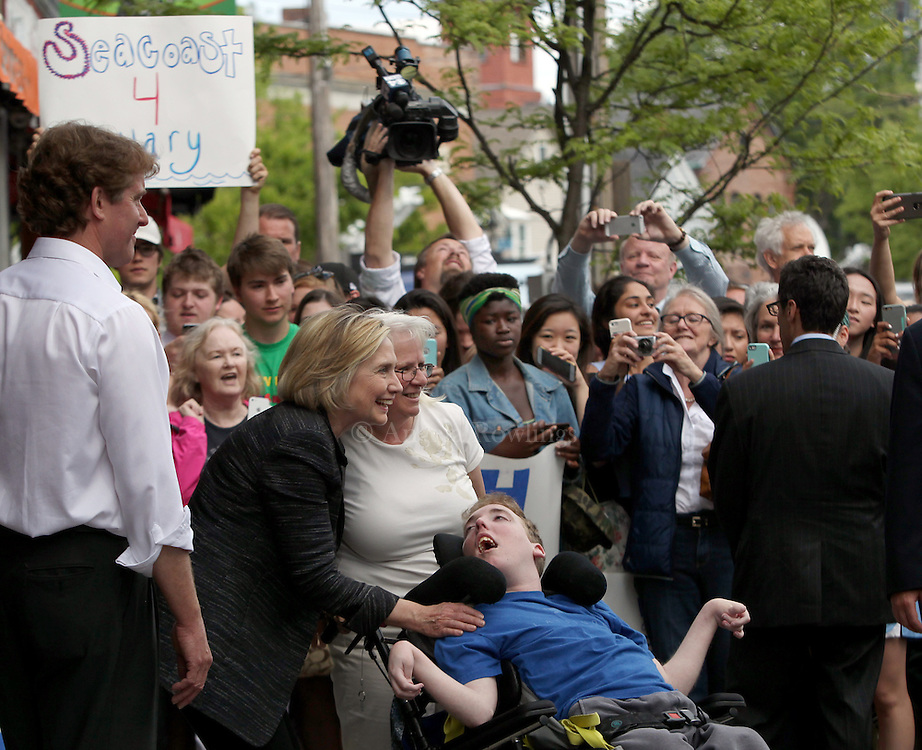 (Exeter, NH - 5/22/15) Former Secretary of State and presidential candidate Hillary Clinton poses for a photo with Diane Champlin of Barrington, N.H., and Ben Hassan [N.H. Gov. Maggie Hassan's son] following a campaign stop in Exeter, Friday, May 22, 2015. Staff photo by Angela Rowlings.