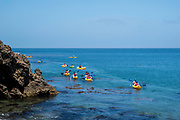 People paddle near Santa Cruz Island, Channel Islands National Park, California, USA.