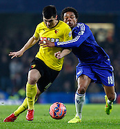 Loic Remy of Chelsea (right) and Fernando Forestieri of Watford during the FA Cup match at Stamford Bridge, London<br /> Picture by David Horn/Focus Images Ltd +44 7545 970036<br /> 04/01/2015