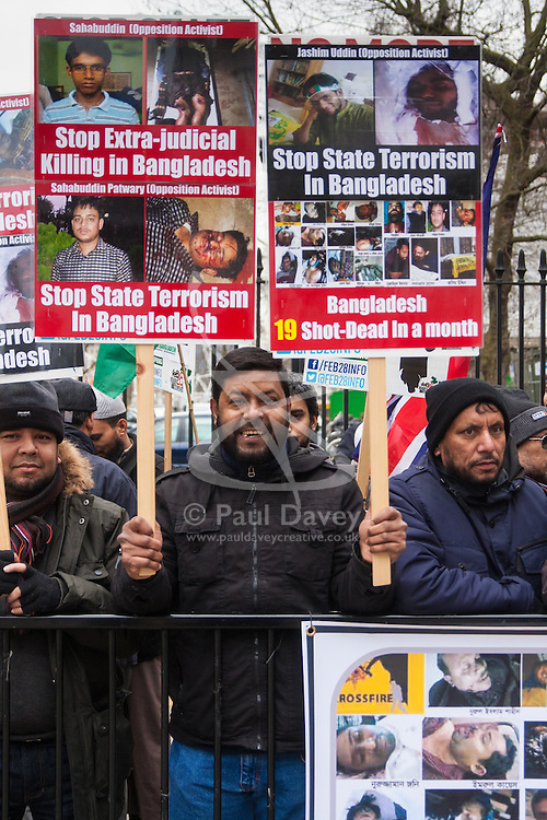 """London, February 10th 2015. Scores of UK Bangladeshis from  Save Bangladesh demonstrate outside Downing Street ahead of handing a letter to David Cameron appealing for him to put pressure on the ruling Awami League to hold free and fair elections and to end """"extra-judicial killings"""" and political violence."""