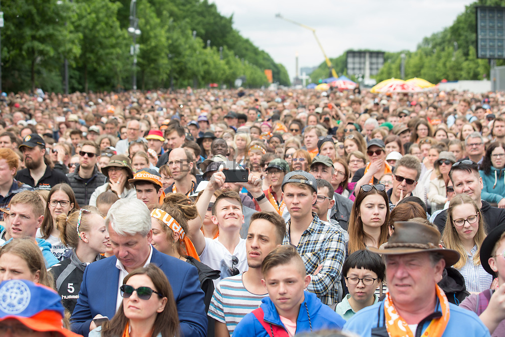 Berlin, Germany - 25.05.2017<br /> <br /> The German Protestant Church Assembly (&quot;Deutscher Evangelischer Kirchentag&rdquo;) in Berlin. Tens of thousands attend the church convention talk of Angela Merkel and Barack Obama in front of the Brandenburg Gate.<br /> <br /> Deutscher Evangelischer Kirchentag 2017 in Berlin. Zehntausende verfolgen das Kirchentag-Gespraech mit Angela Merkel und Barack Obama am Brandenburger Tor. <br /> <br /> Photo: Bjoern Kietzmann