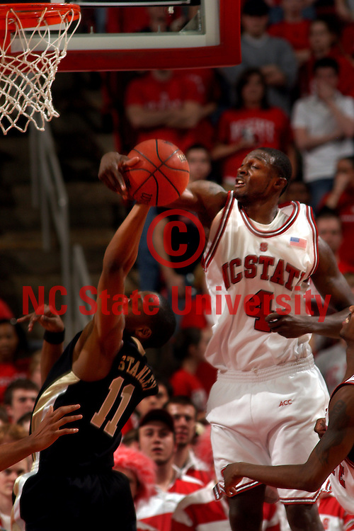 Wolfpack guard Courtney Fells rejects a Wake shot.   PHOTO BY ROGER WINSTEAD