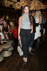 ROXIE NAFOUSI at the Launch Of Osman Yousefzada's 'The Collective' 4th edition with special guest collaborator Poppy Delevingne held in the Rumpus Room at The Mondrian Hotel, 19 Upper Ground, London SE1 on 24th November 2014, sponsored by Storm models and Beluga vodka.