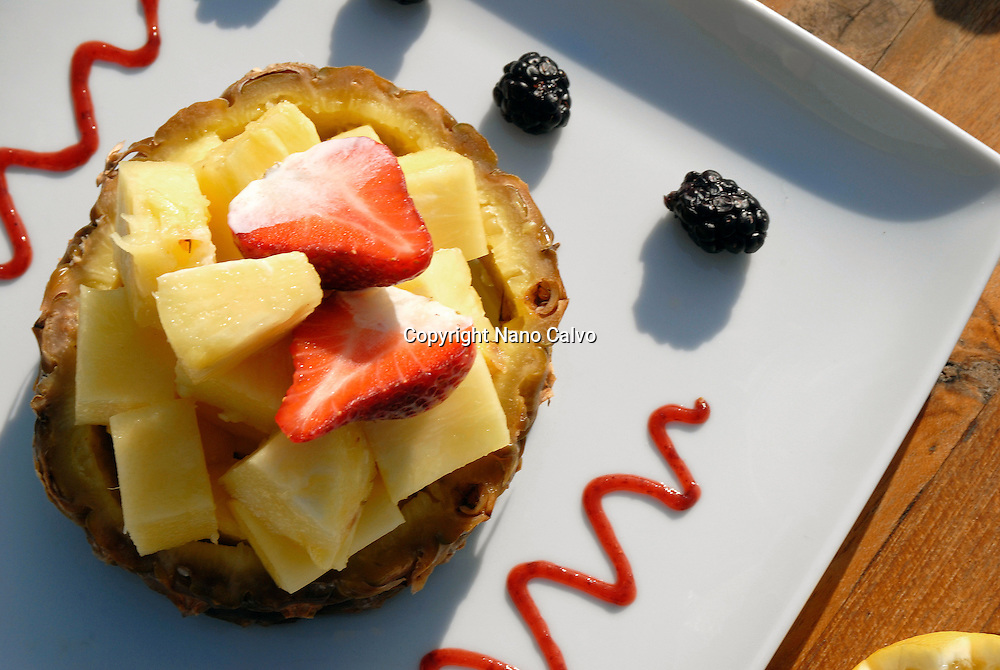 Tasty dessert made of pineapple, strawberry and other fruits