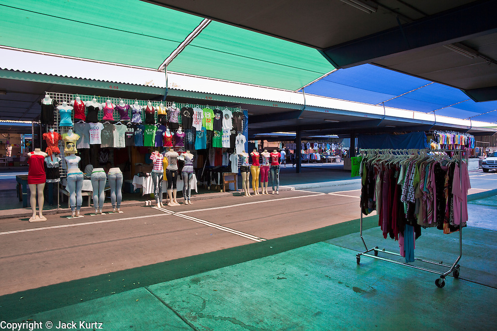 July 25 - PHOENIX, AZ: An isolated clothing stall in El Gran Mercado. El Gran Mercado (The Big Market) in Phoenix is the largest flea market in the Phoenix area and has served the area's immigrant community for more than 20 years. With more than 150 small independent stalls selling Mexican clothes, cowboy hats, Mariachi music and food stalls selling Mexican favorites like birria chivo (goat stew) and menudo (tripe) it was more like a Mexican market than an American mall. Business in the mercado is down more than half this year because many immigrant families, legal and illegal, are leaving Arizona before the state's tough new anti-immigrant law, SB 1070 goes into effect on July 29. SB 1070 allows local police officers to check the immigration status of people they have probable cause to believe may be in the US illegally and requires immigrants to carry their immigration papers with them at all times.    Photo by Jack Kurtz